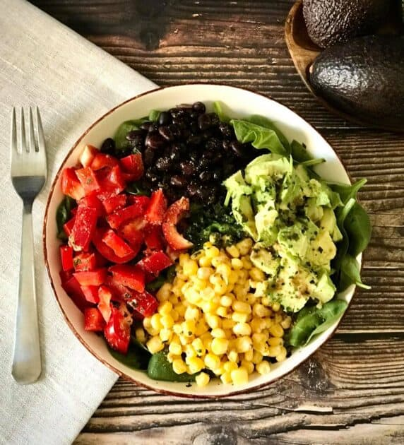 salad with avocado, corn, bell peppers, and black beans