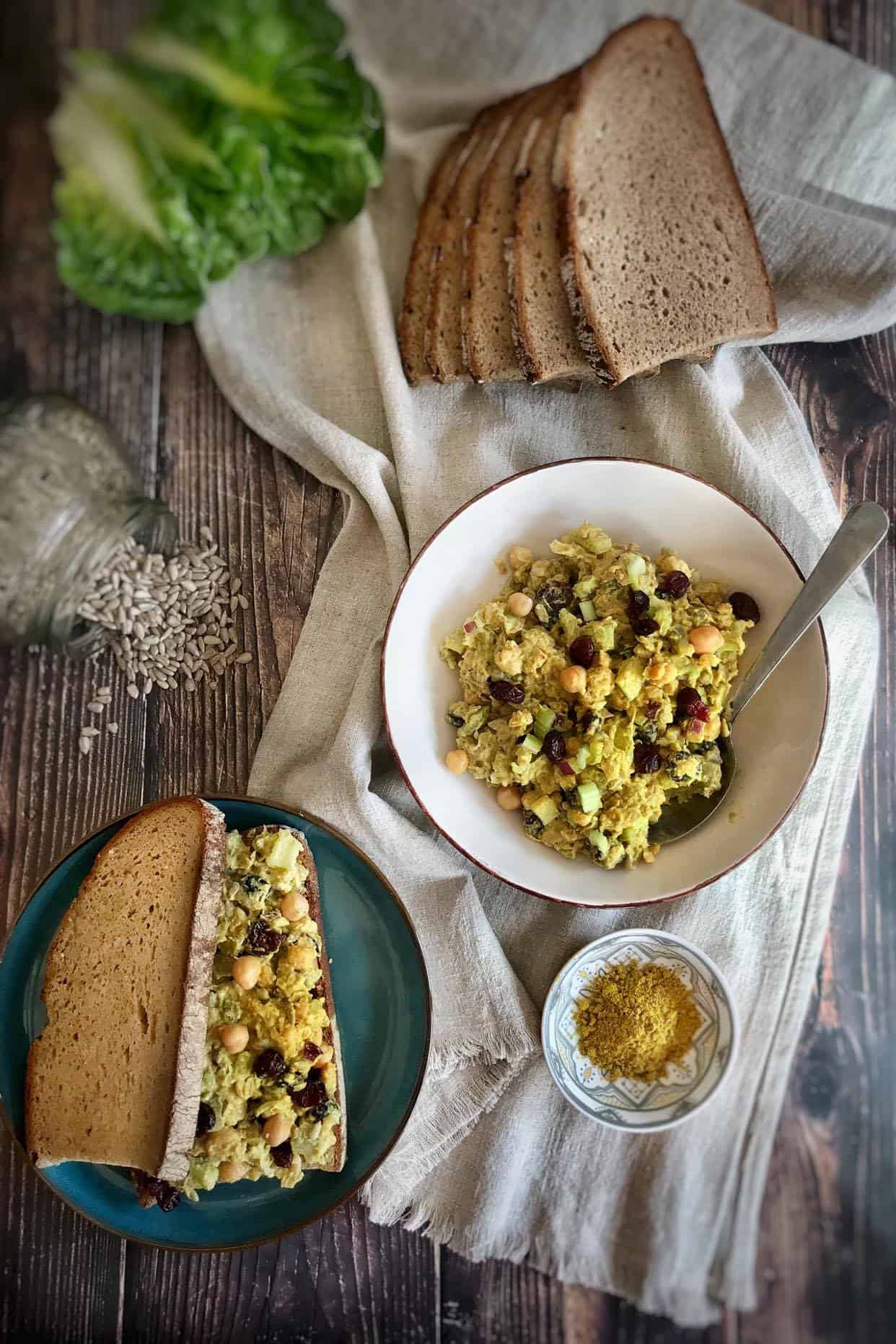 vegan curry chickpea salad with bread and lettuce