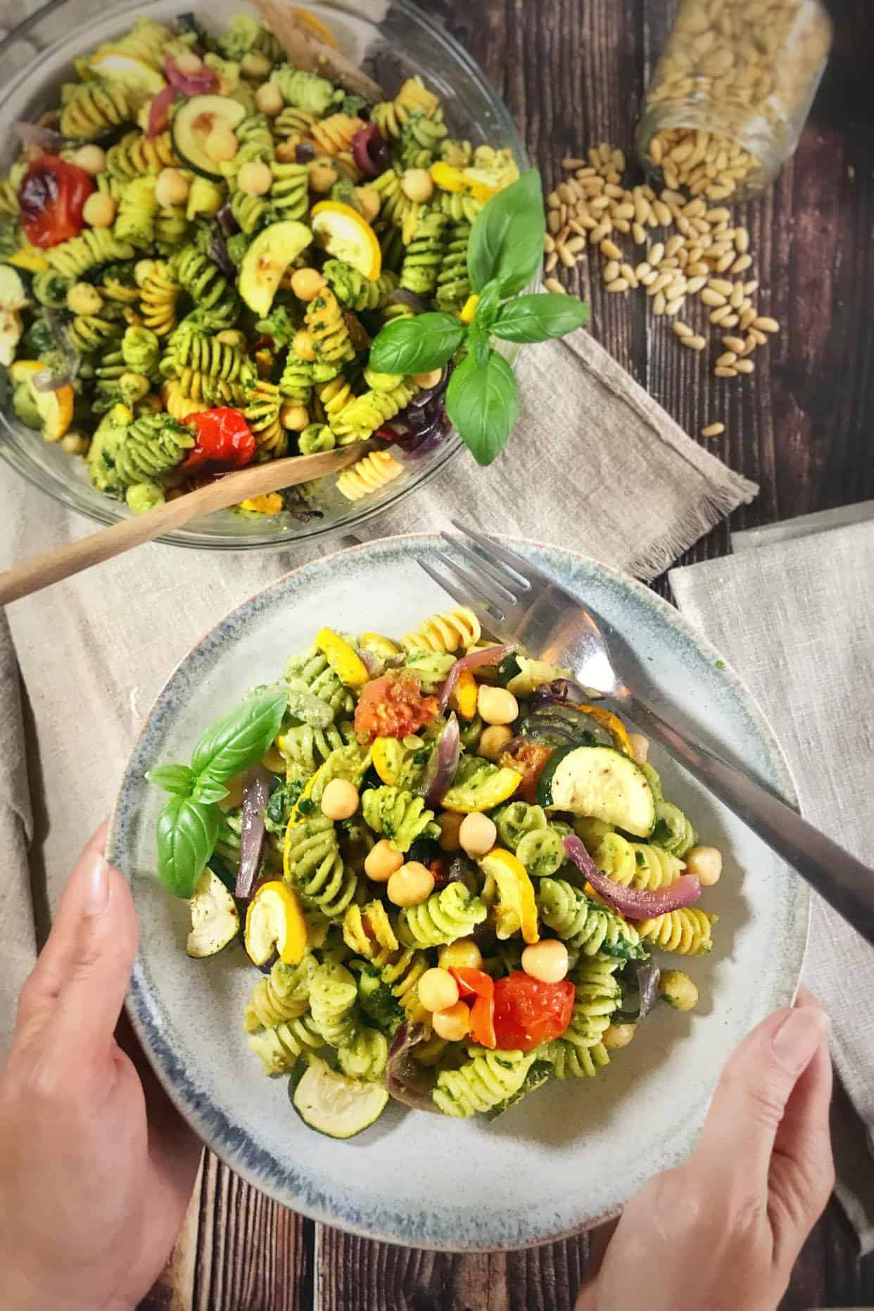 vegan pesto pasta salad with pine nuts and chickpeas