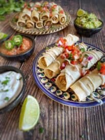 Baked vegan taquitos on a plate.