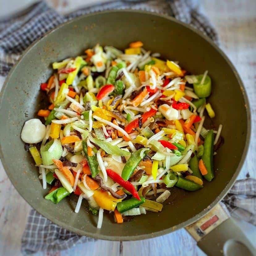 Frozen vegetables in a skillet.