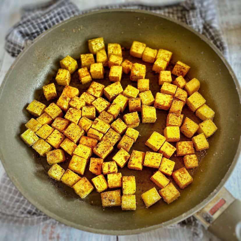 Seared tofu cubes in a skillet.