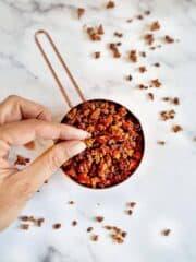 vegan bacon bits in measuring cup