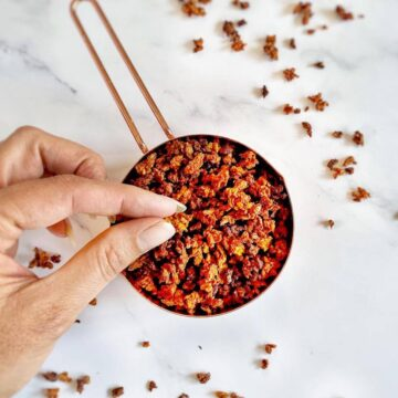 vegan bacon bits in measuring cup