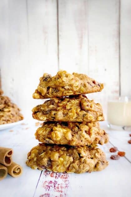 Vegan oatmeal raisin cookies stacked.
