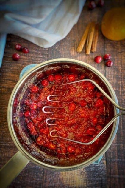 Mash the cranberries.