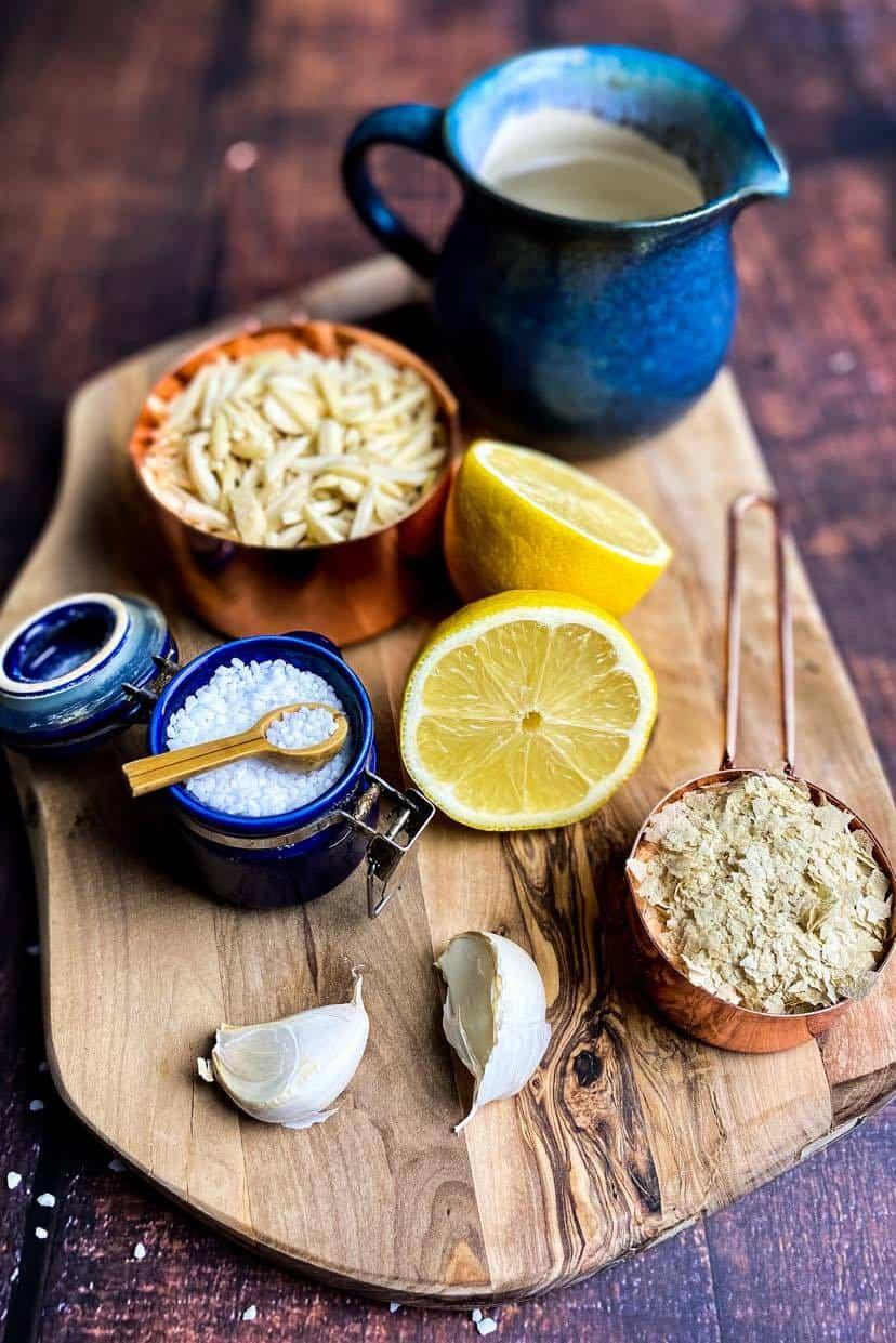 Vegan Ricotta ingredients: almond slivers, salt, nutritional yeast, lemon juice, garlic, and water.