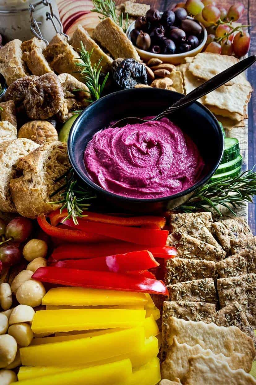 vegan snack board with red beet hummus