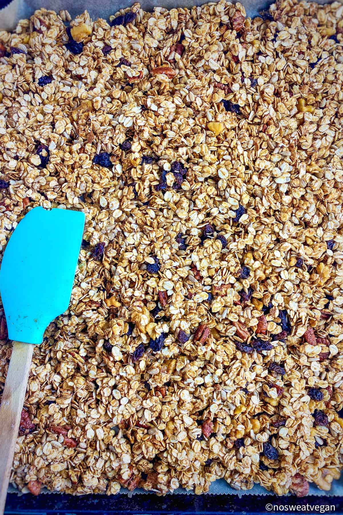 press the raw granola into the baking sheet