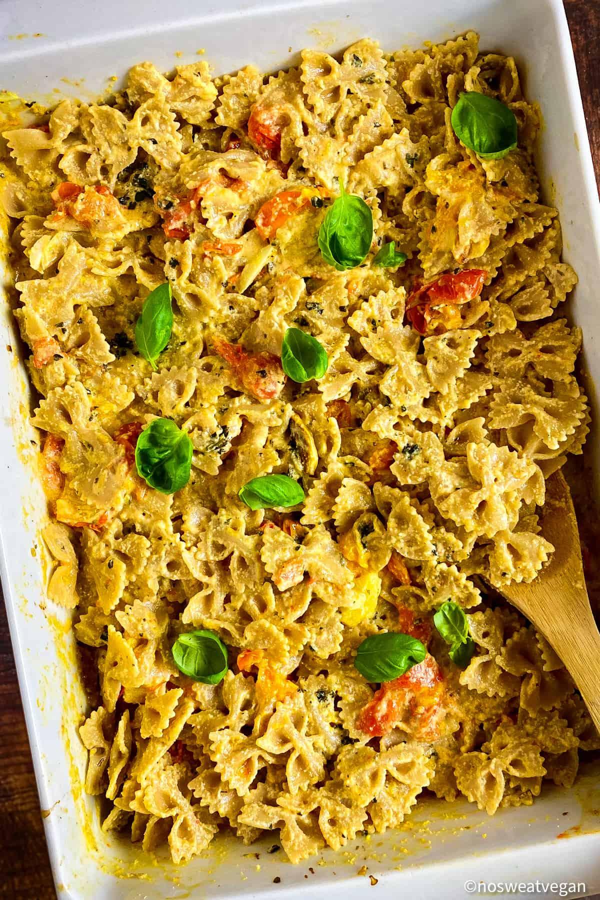 Baked vegan feta pasta in a baking dish.