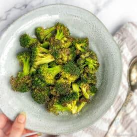 Air fryer broccoli in bowl.