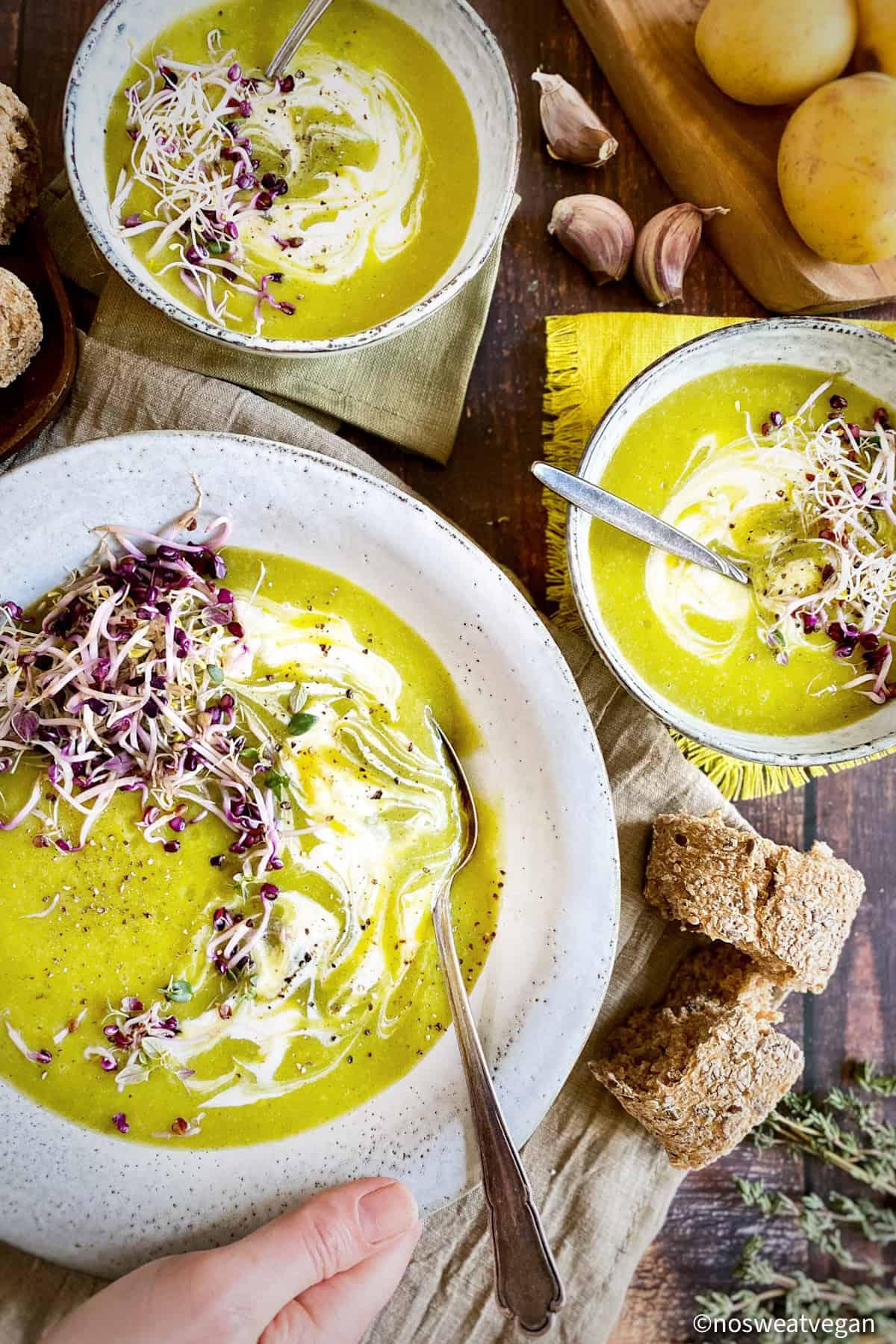 Potato leek soup in 3 bowls.