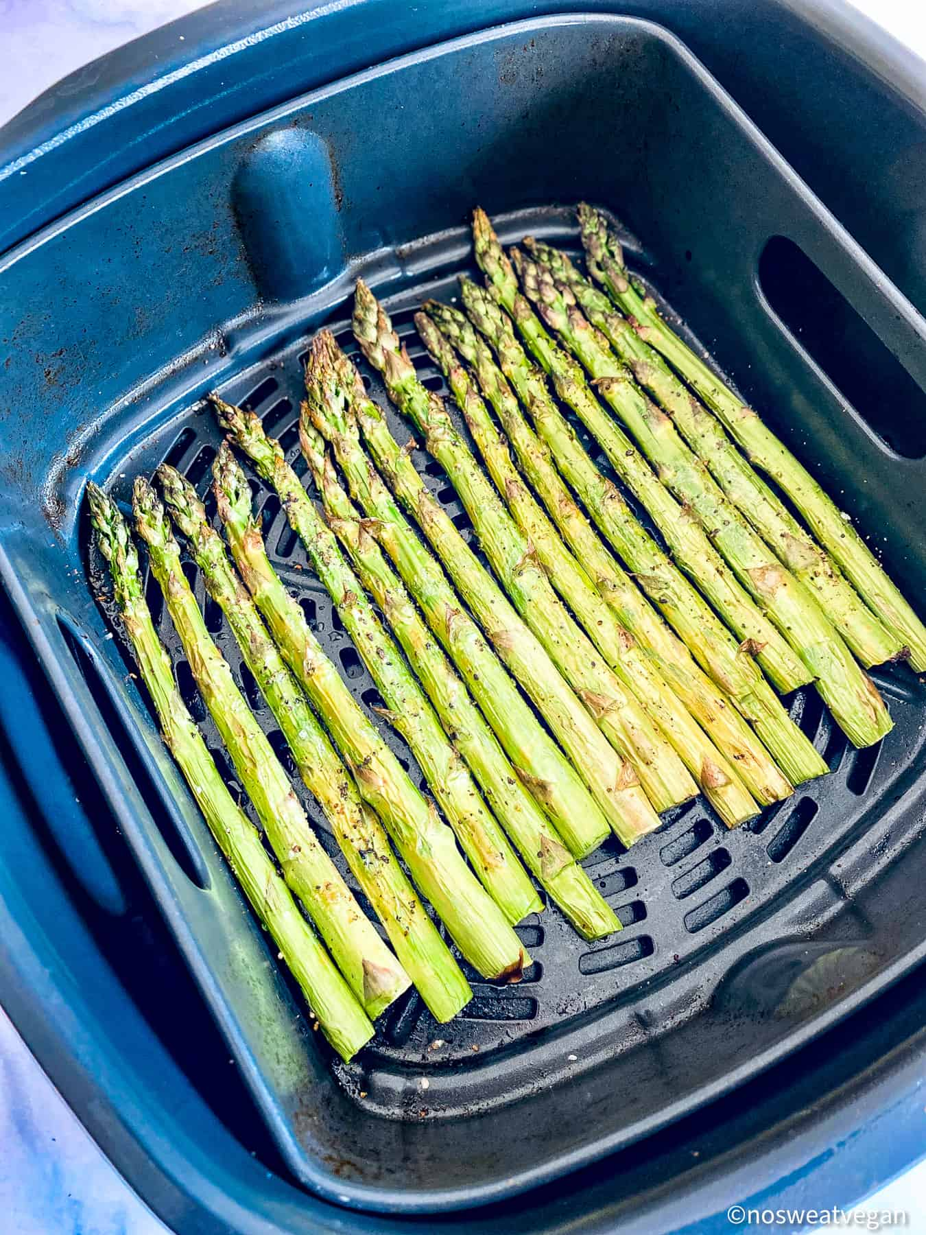 Crispy roasted asparagus in air fryer.