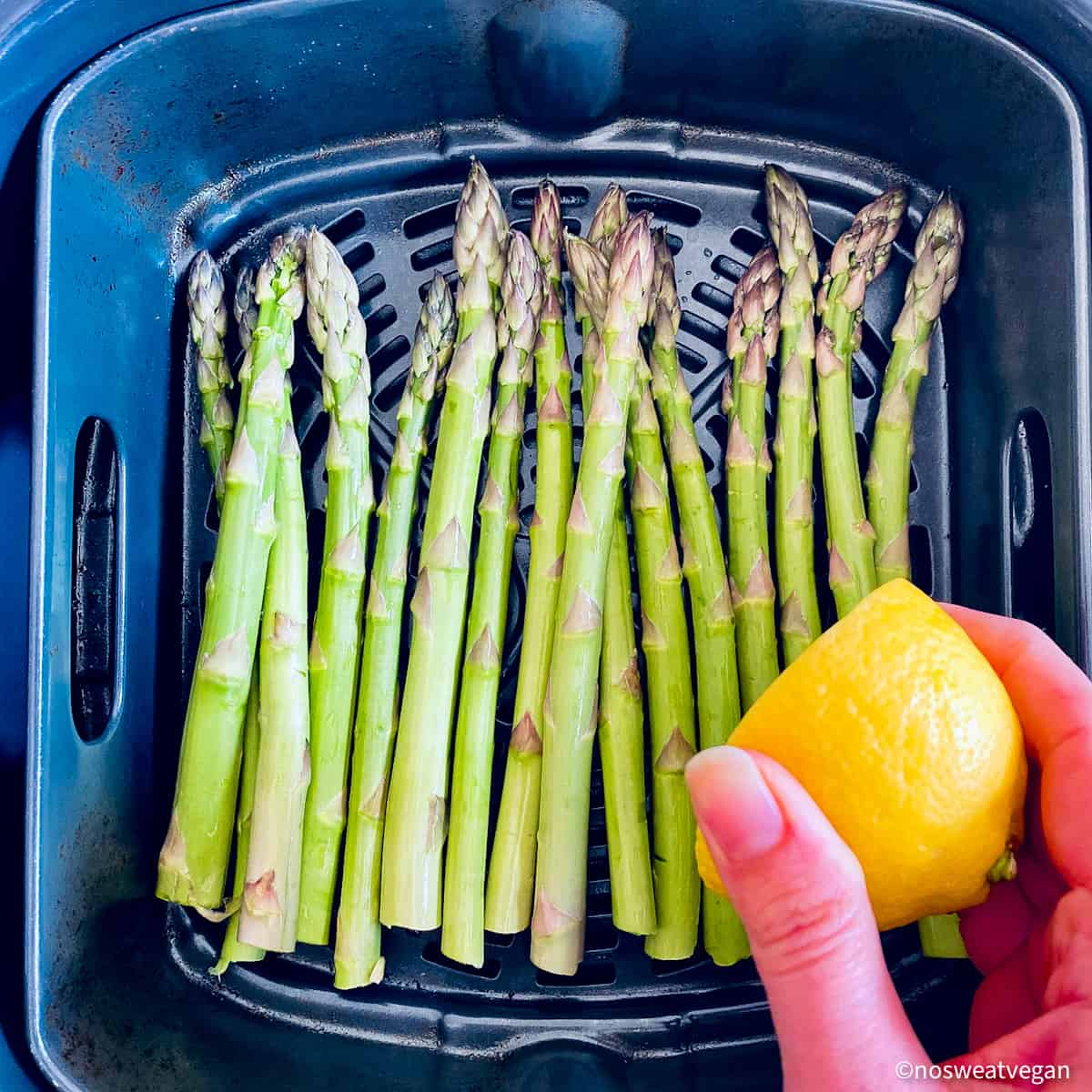 Asparagus in air fryer with lemon juice.