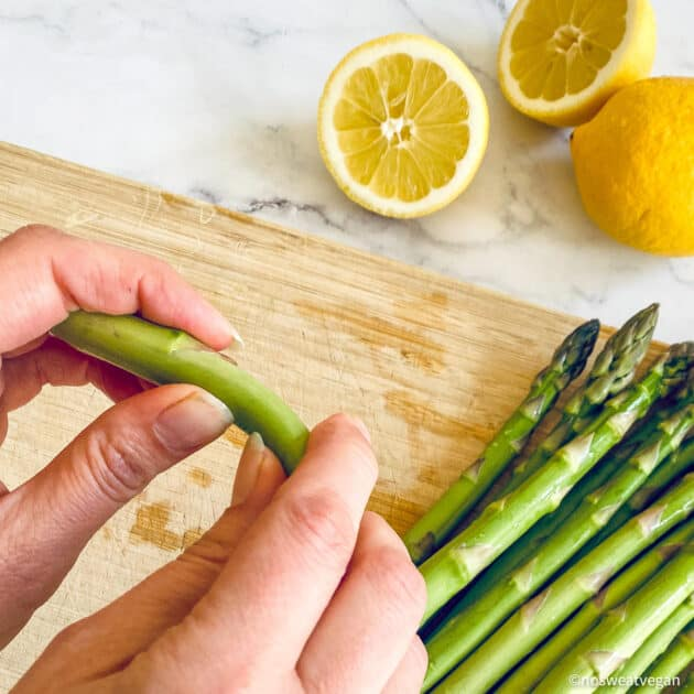 Snap off the woody end of the asparagus.