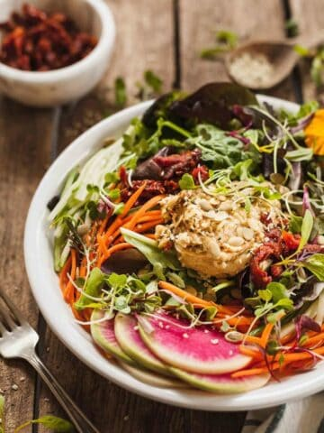 Hummus salad with greens.