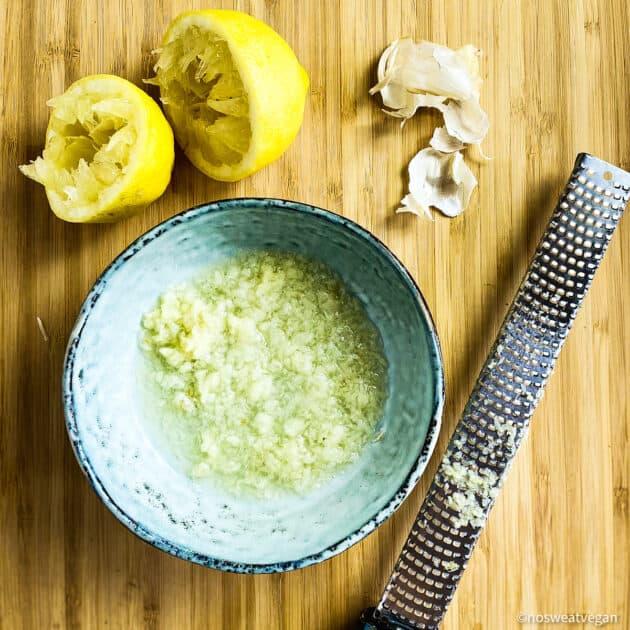 Minced garlic in lemon juice in a bowl.