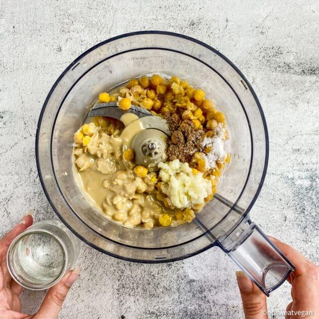 Oil-free hummus ingredients in a food processor.