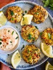 Vegan crab cakes on plate with remoulade sauce.