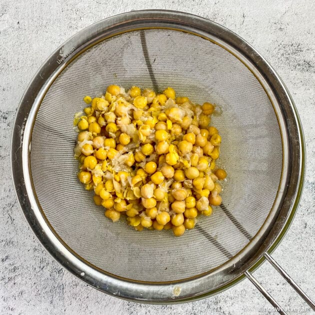 Boiled chickpeas in a colander.
