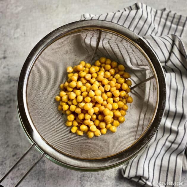 Drained and rinsed chickpeas in a colander.