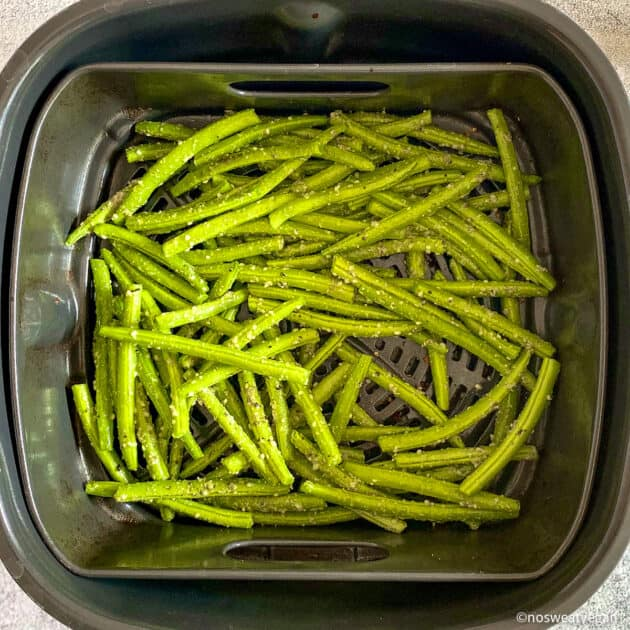 Fresh, seasoned green beans in the air fryer.