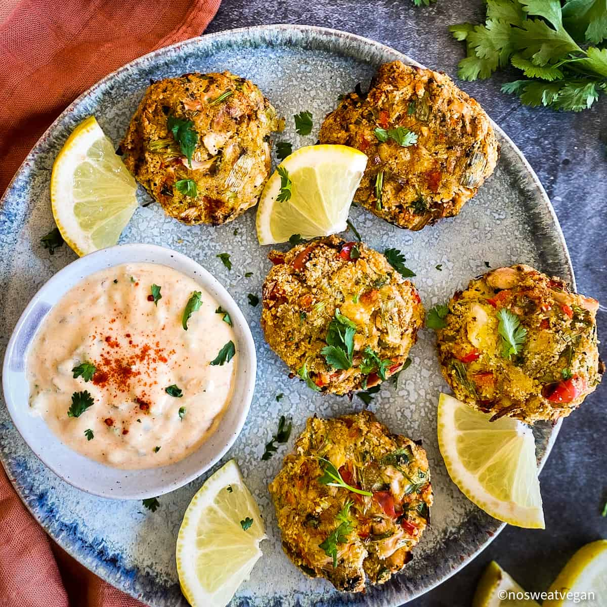 Vegan remoulade on plate with vegan crab cakes.
