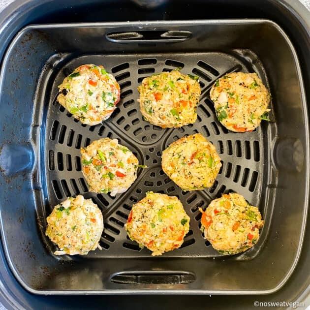 Vegan crab cakes uncooked in air fryer.