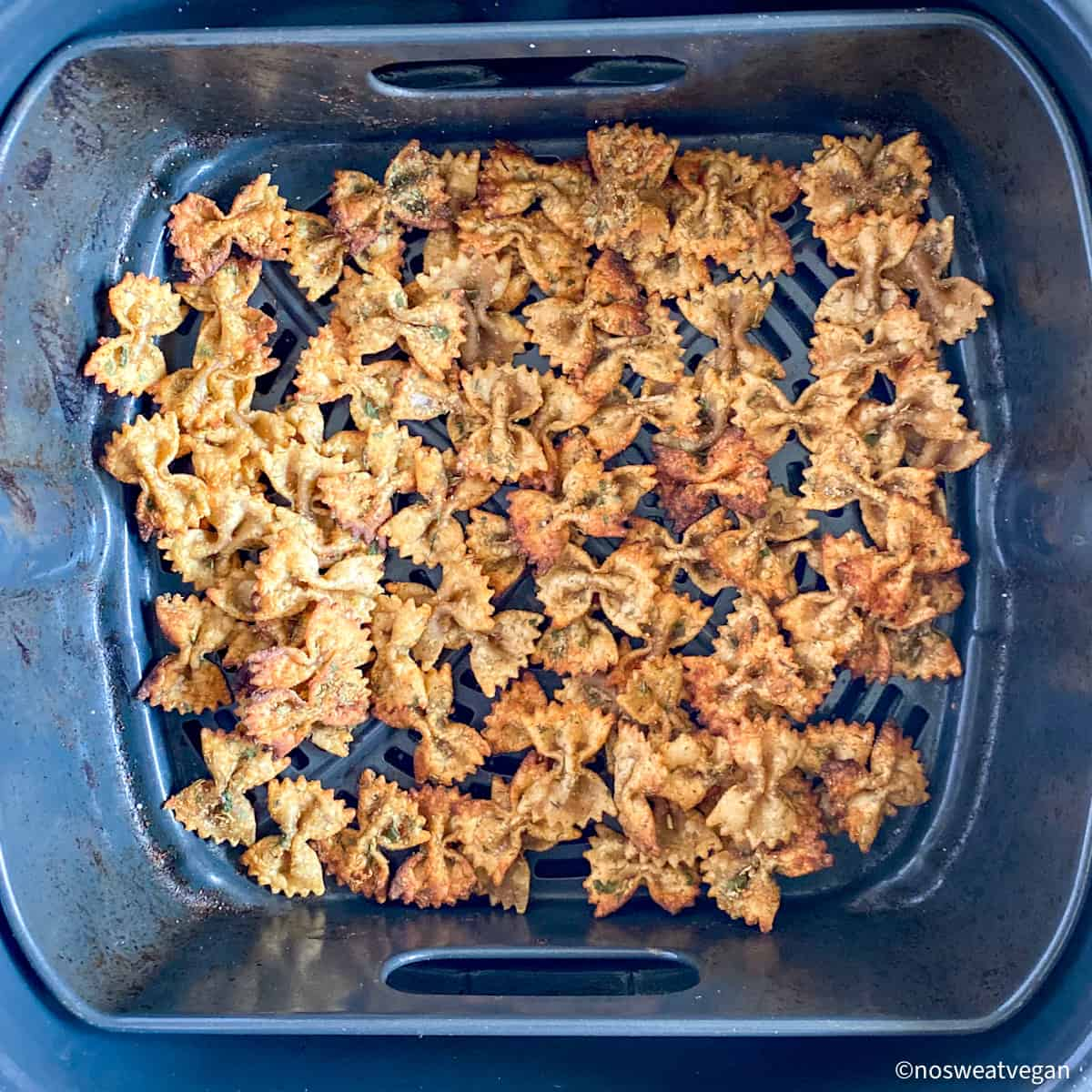 Air fried pasta chips in basket.