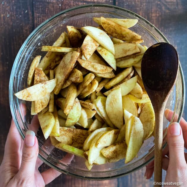 Apple slices mixed with seasonings.