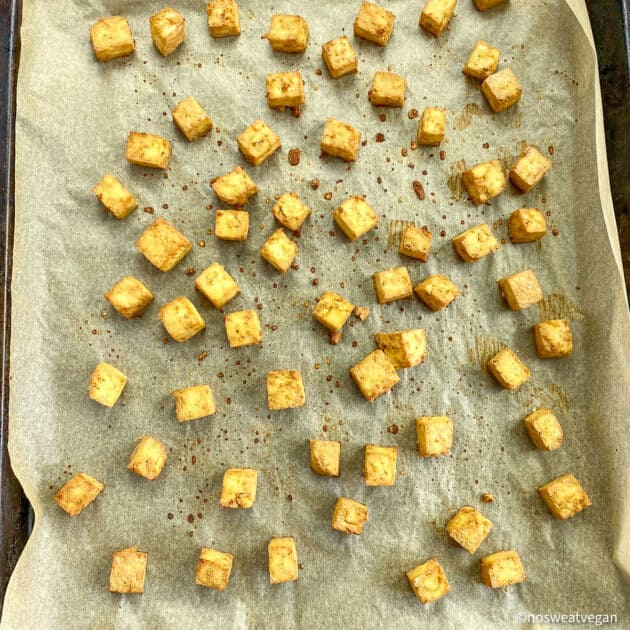 Cubed tofu on baking sheet (cooked).