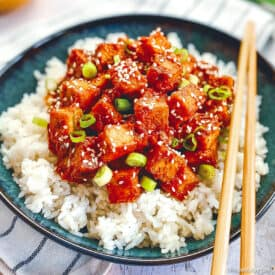 Vegan Korean tofu in bowl with rice and chopsticks.