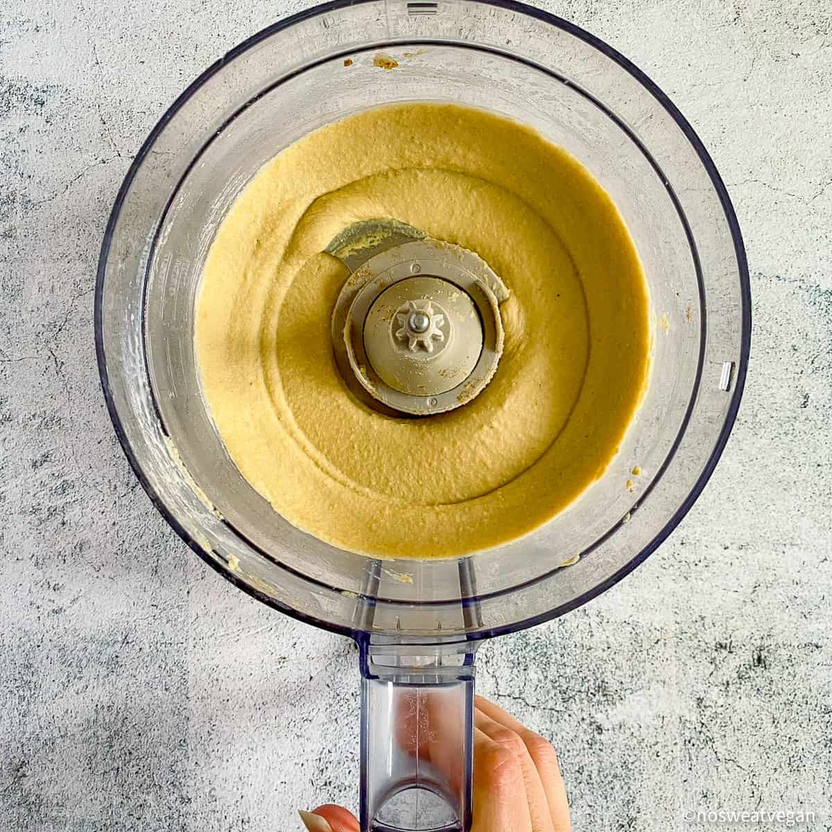 Creamy oil-free hummus in food processor.