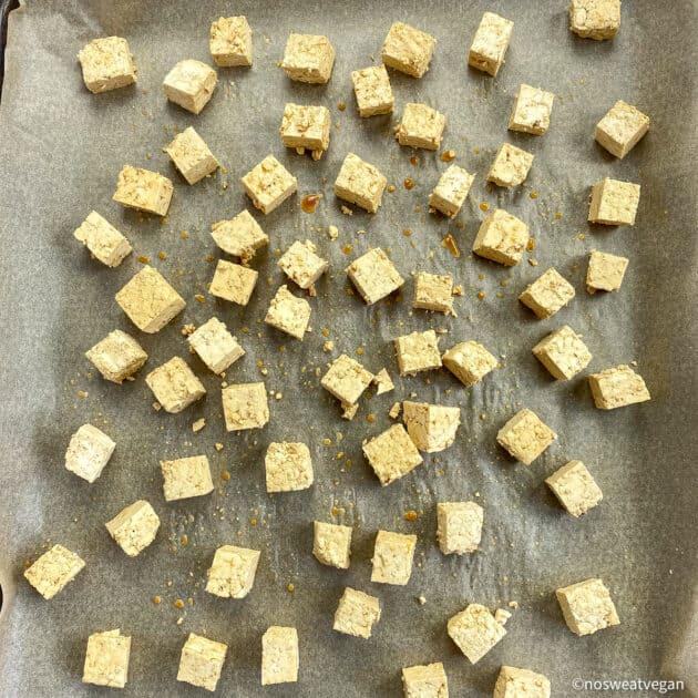 Cubed tofu on baking sheet (uncooked).