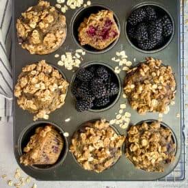 Vegan blackberry muffins in pan.
