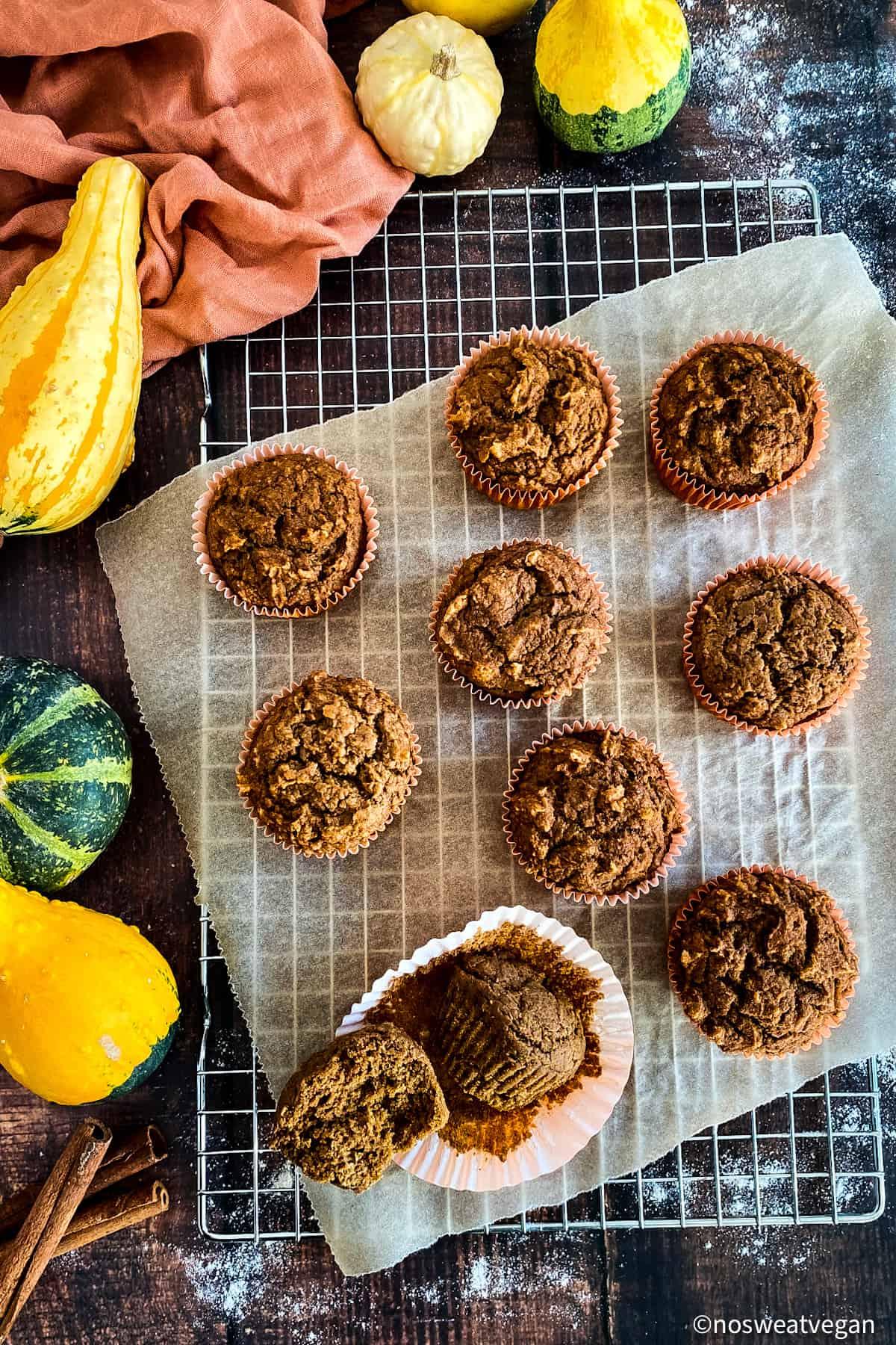 Pumpkin muffins on a cooling rack.