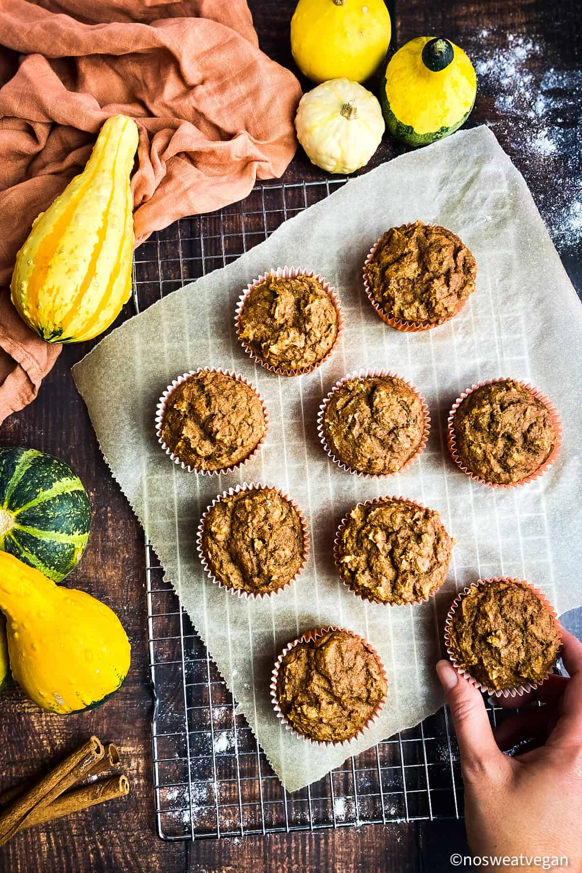 Healthy pumpkin muffins on drying rack.