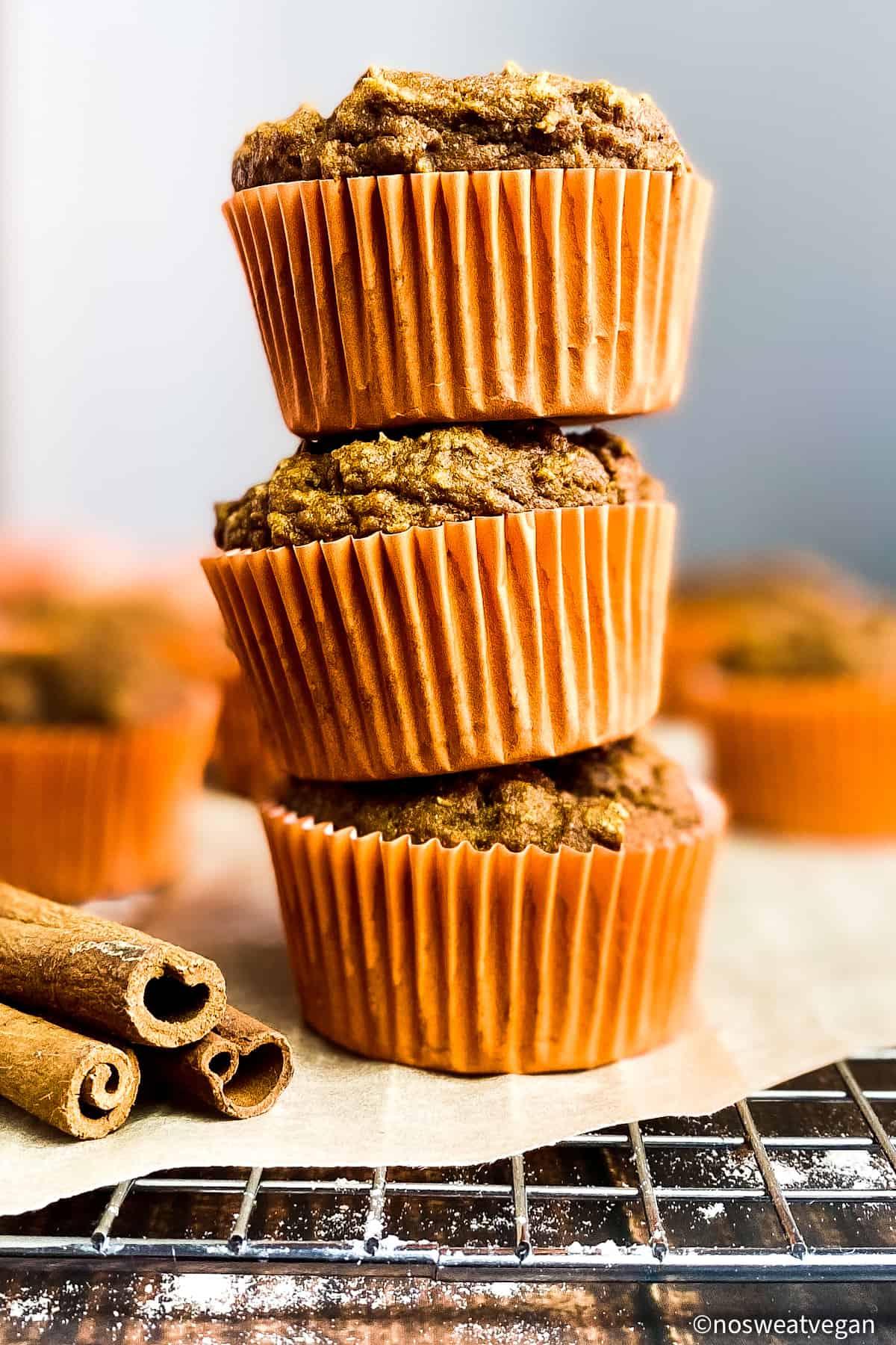 Vegan pumpkin muffins, stacked.